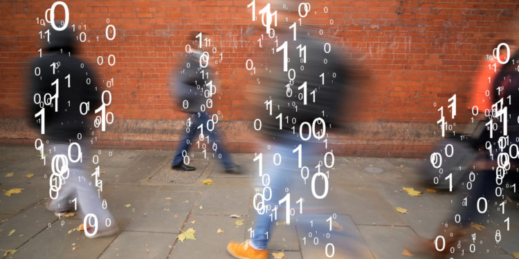 Men and women walking past the camera and overlaid with fast changing binary code.